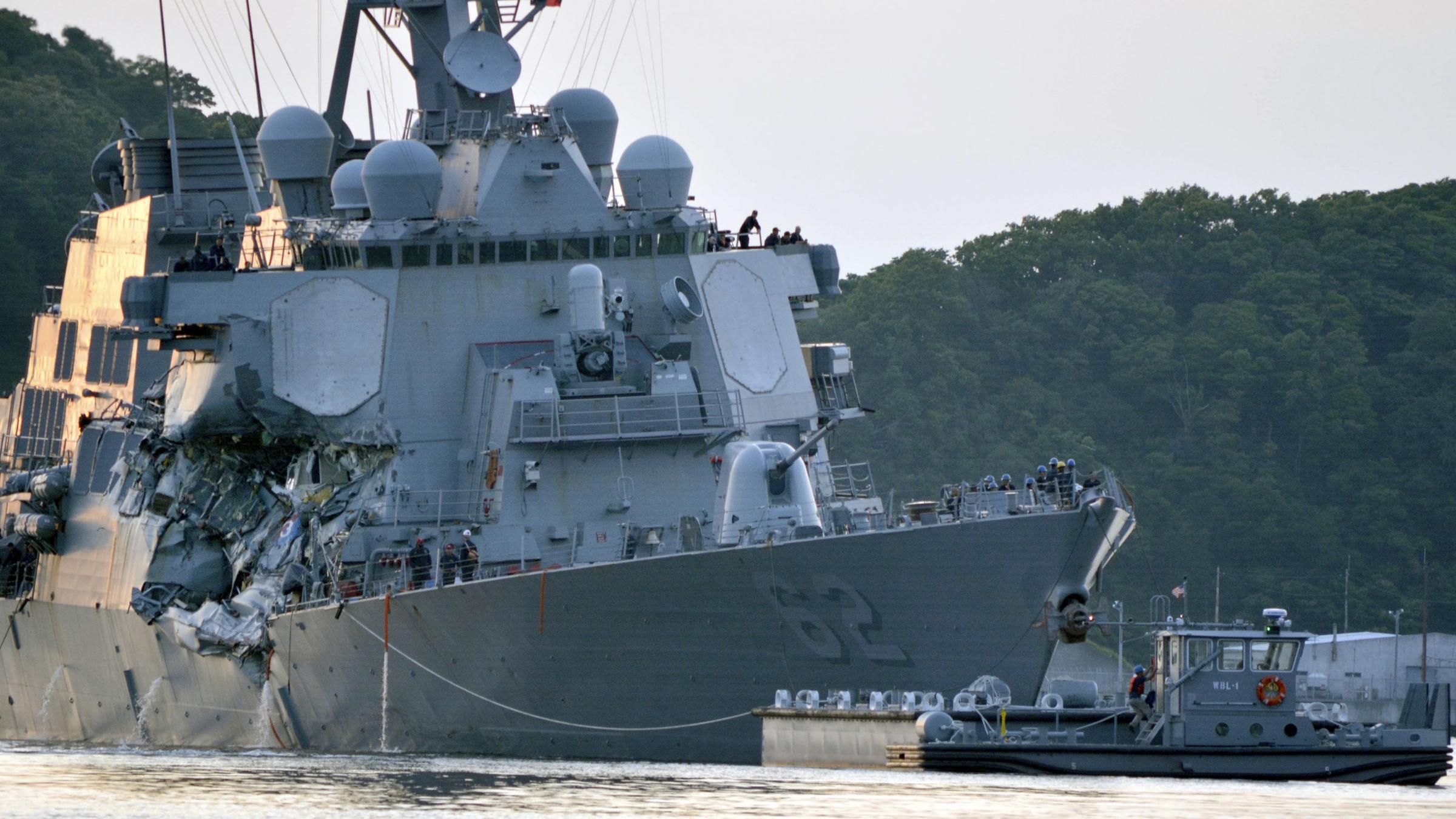 Bodies found on 'ripped' U.S. destroyer